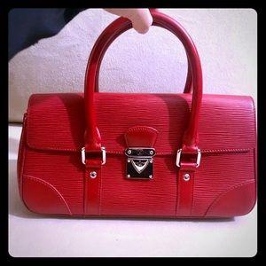 Louis Vuitton Pochette Segur Epi Leather Handbag